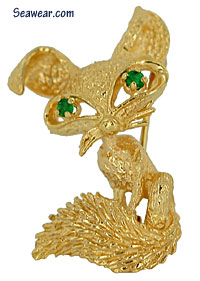 foxy fox with bushy tail brooch pin with emerald eyes