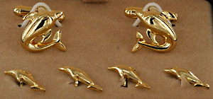gold tone porpoise dolphin cufflinks and stud set