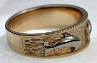 side view of leaping dolphins white dolphin on yellow ring - Dolphin Wedding Rings