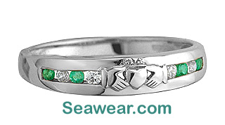 white gold Claddagh enternity band with emeraldsand diamonds