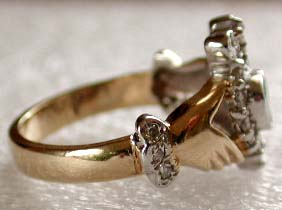 diamonds in the cuff of the Claddagh