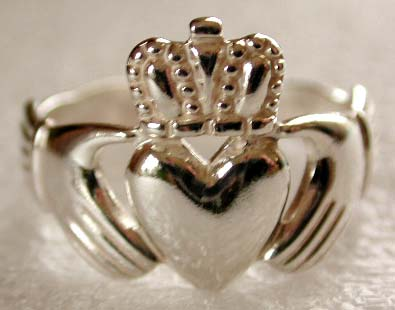 Made of a pair of hands holding a crowned heart, it symbolizes love (heart),