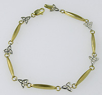 14k trinity knot and Ogham bar bracelet in white and yellow gold