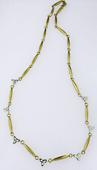 14k trinity knot and ogham bar necklace in white and yellow gold