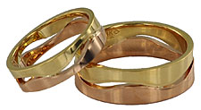 sunrise sunset rose and yellow gold wedding bands