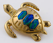 sea turtle slide with opal inlay